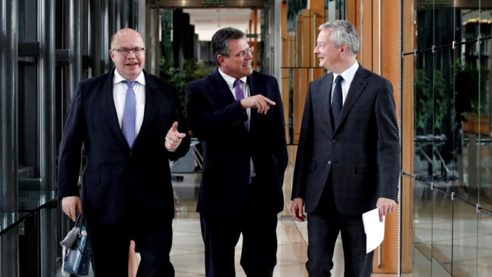 German Minister of Economy and Energy Peter Altmaier, European Commission Vice-President Maros Sefcovic and French Economy and Finance Minister Bruno Le Maire leave a meeting on the development and production of European batteries in Paris