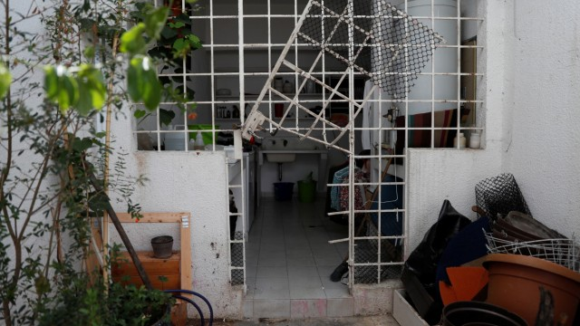 A damaged gate is seen at the residence of opposition leader Leopoldo Lopez and his family, after unidentified government officials illegally entered the house, according to the family's lawyer Omar Mora Tosta, in Caracas