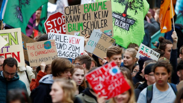 Protesters of the Fridays for Future movement march through the city of Essen to protest against German utility RWE during the company's annual shareholders meeting in Essen