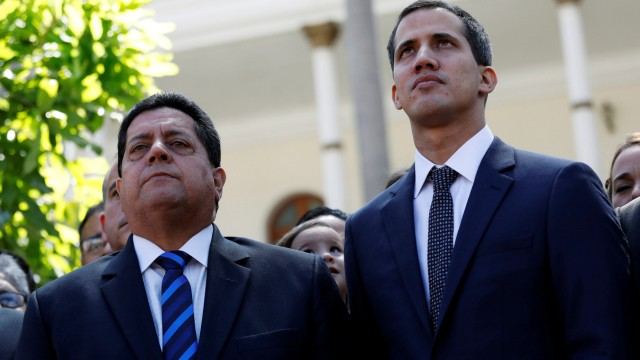 FILE PHOTO: Juan Guaido, new President of the National Constituent Assembly and lawmaker of the Venezuelan opposition party Popular Will, and lawmaker Edgar Zambrano of Democratic Action party, leave the congress in Caracas