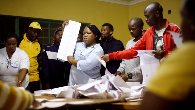 Election officials and observers begin counting votes after stations closed for voting in Embo near Durban