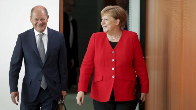 Koalitionsspitzen einigen sich auf Verbesserungen für Paketboten: Merkel und Scholz