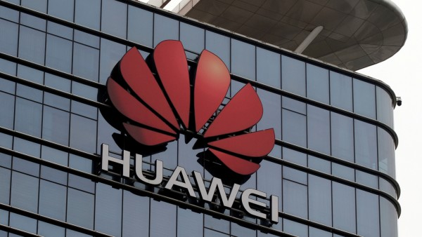 FILE PHOTO: The Huawei logo is pictured outside its Huawei's factory campus in Dongguan, Guangdong province