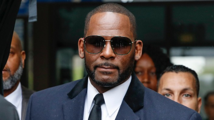 Singer R Kelly scheduled to appear for a hearing after being charged  with 10 counts of aggravated sexual abuse