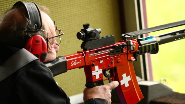 Swiss flags are pictured on the rifle of a participant to the Fribourg County 300m riffle final at the shooting range in Romont