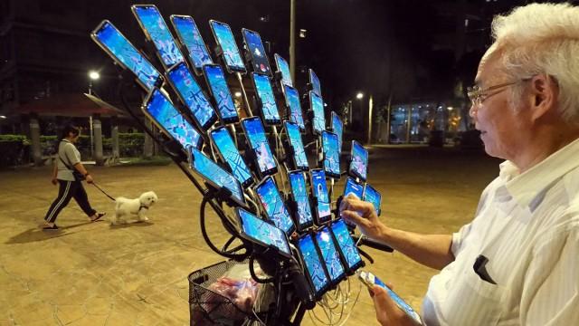 Taiwan man mounts 29 cellphones onto bike to catch Pokemon, New Taipei City - 14 May 2019