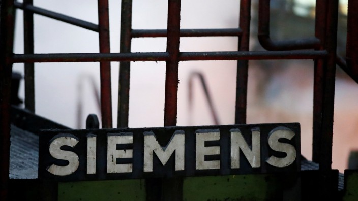 FILE PHOTO: A sign of Germany's industrial group Siemens AG is pictured at a primary rolling mill of Germany's largest steel factory of ThyssenKrupp Steel AG in Duisburg