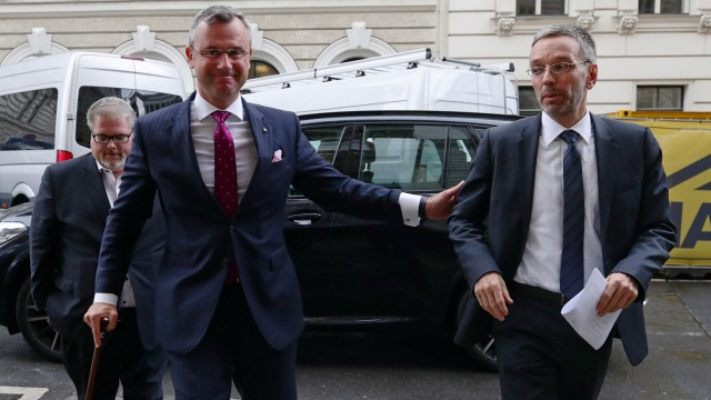 Designated new Chief of Freedom Party Norbert Hofer and Interior Minister Herbert Kickl arrive to address a news conference in Vienna