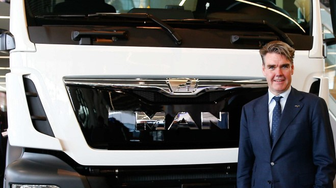 Drees CEO of German truck maker MAN SE, poses in front of a MAN truck in Munich