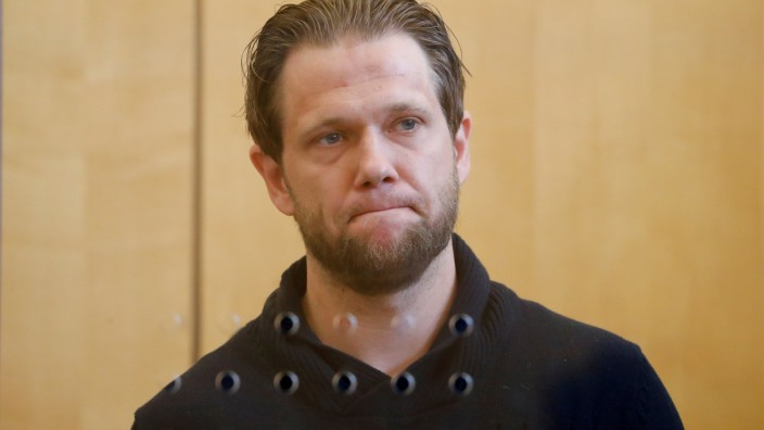 FILE PHOTO: Salafist preacher Sven Lau appears behind a bullet-proof window at a high-security courtroom in Duesseldorf