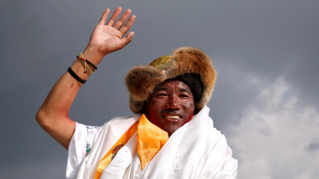 FILE PHOTO: Kami Rita Sherpa, 48, a Nepali mountaineer waves towards the media personnel upon his arrival after climbing Mount Everest for a 22nd time, creating a new record for the most summits of the worldÕs highest mountain, in Kathmandu