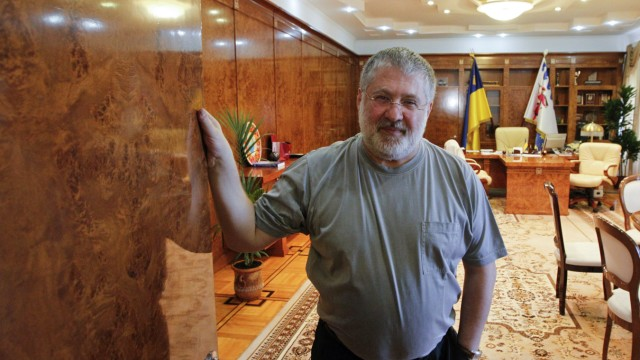Igor Kolomoisky, billionaire and governor of the Dnipropetrovsk region poses for a picture at his cabinet in the regional government headquarters in Dnipropetrovsk