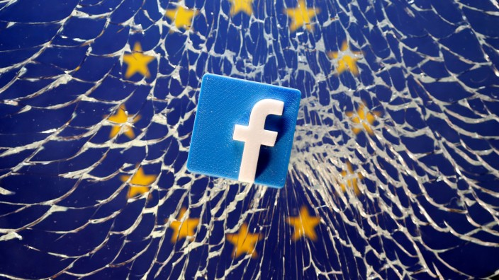 FILE PHOTO: A 3D printed Facebook logo is placed on broken glass above a printed EU flag in this illustration
