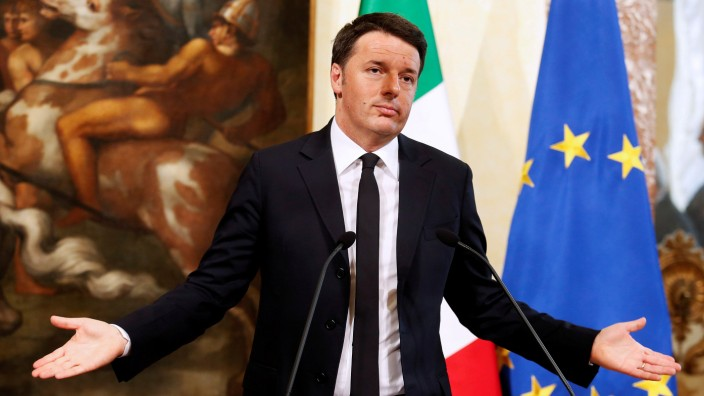 FILE PHOTO: Italy's Prime Minister Matteo Renzi gestures during a news conference in Rome