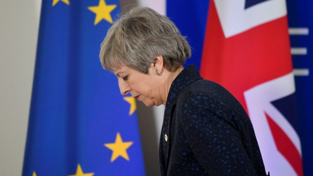 FILE PHOTO: Britain's PM Theresa May leaves after giving a news briefing in Brussels