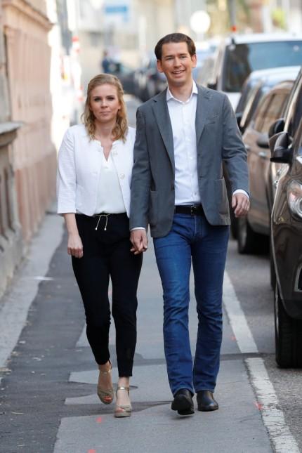 Austrian Chancellor Sebastian Kurz and his girlfriend Susanne Thier arrive to cast their votes during European Parliament Elections in Vienna