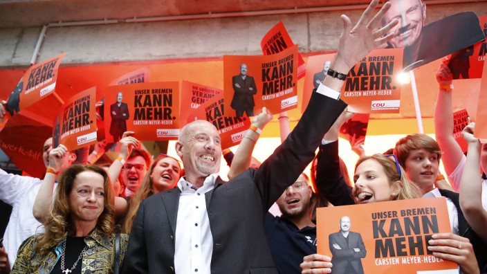 Carsten Meyer-Heder, Germany's Christian Democratic Union party (CDU) top candidate for the German city-state of Bremen parliamentary elections reacts after first election polls were published in Bremen