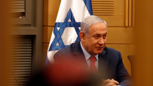 Israeli Prime Minister Benjamin Netanyahu attends a Likud party meeting at the Knesset, Israel's parliament, in Jerusalem