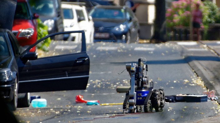 A bomb disposal robot inspects a suspect car in Woluwe Saint Pierre outside of Brussels Belgium on