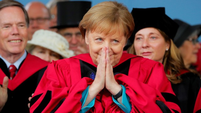 German Chancellor Angela Merkel acknowledges the applause as she receives an honorary degree during Commencement Exercises at Harvard University in Cambridge