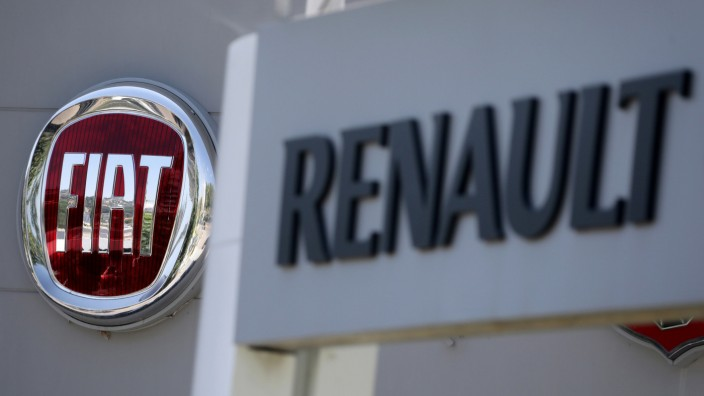 FILE PHOTO: The logos of Renault and Fiat carmakers are seen in Nice