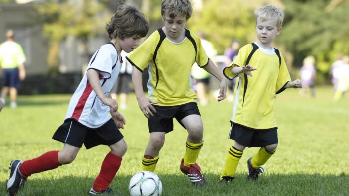 Young Boys Playing Soccer Toronto Ontario PUBLICATIONxINxGERxSUIxAUTxONLY Copyright BrianxSummers