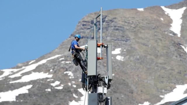 A technician installs 5G antennas of Swiss telecom operator Swisscom in Lenzerheide