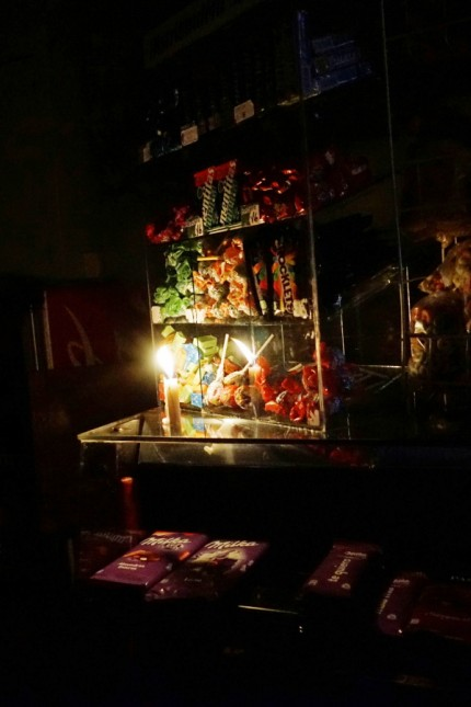 Sweets for sale are seen inside a store lit by candlelight after a massive blackout in Argentina, in Montevideo