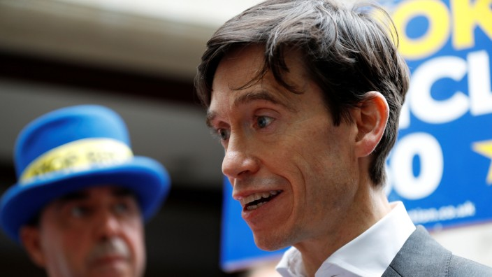 PM hopeful Rory Stewart emerges from TV studios in Westminster, London