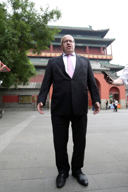 Germany's Economy Minister Peter Altmaier speaks to the media in Beijing