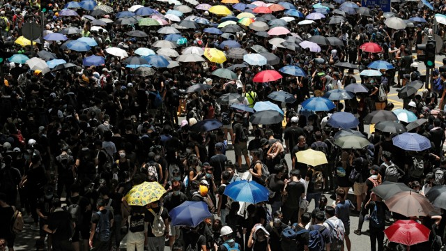 People protest outside police headquarters, demanding Hong KongâÄÖs leaders to step down and withdraw the extradition bill, in Hong Kong