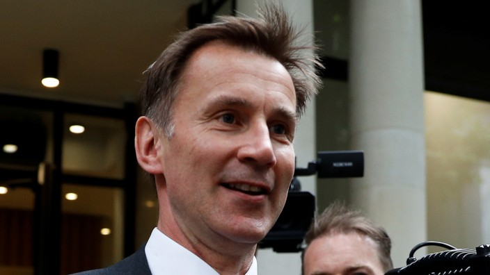 Jeremy Hunt leaves after a leadership hustings