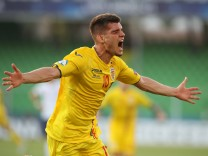 Ianis Hagi celebrates scoring their second goal during the UEFA Under 21 Championship 2019 match at