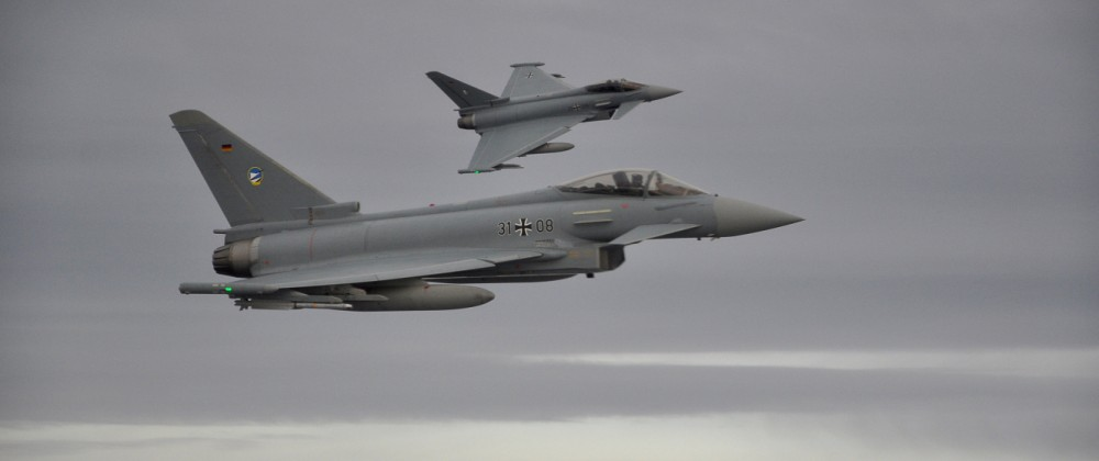 FILE PHOTO: Two German Eurofighter jets simulate the interception of a plane over the Baltic sea