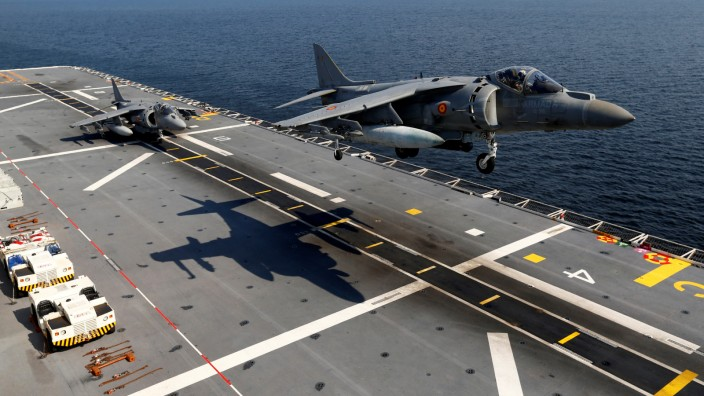 Spanish Navy ground-attack aircrafts AV-8B Harrier II land on the board of the assault ship-aircraft carrier LHD Juan Carlos I during Baltops 2019 NATO military exercise in the Baltic sea near Lilaste