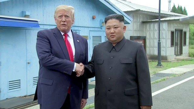 U.S. President Donald Trump meets with North Korean leader Kim Jong Un at the DMZ separating the two Koreas, in Panmunjom