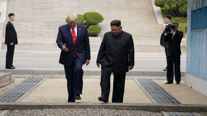 U.S. President Trump and North Korean leader Kim Jong Un meet at the Korean Demilitarized Zone