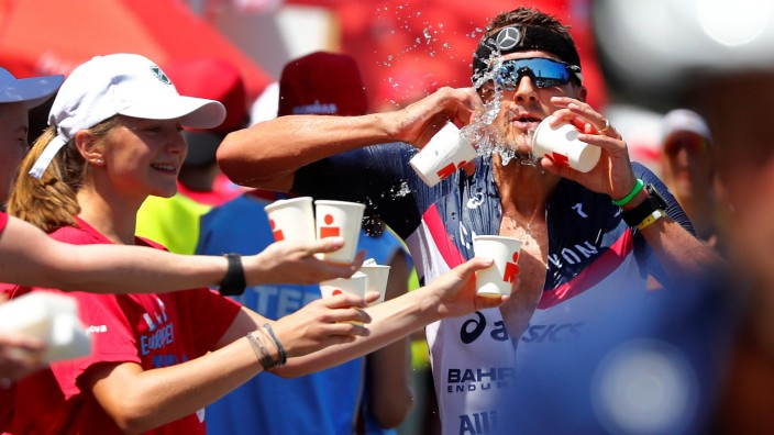 Triathlete Jan Frodeno tries to cool down as he competes in the Ironman triathlon European Championships in Frankfurt