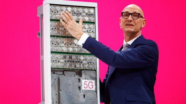 Tim Hoettges, CEO of Deutsche Telekom AG stands in front of an Ericsson 5 G antenna during the company's AGM in Bonn