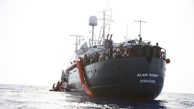 Migrants are evacuated by the crew of a rescue vessel Alan Kurdi