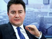 FILE PHOTO: Turkish Deputy Prime Minister Babacan gestures during the session 'Growing in Harder Times' in the Swiss mountain resort of Davos