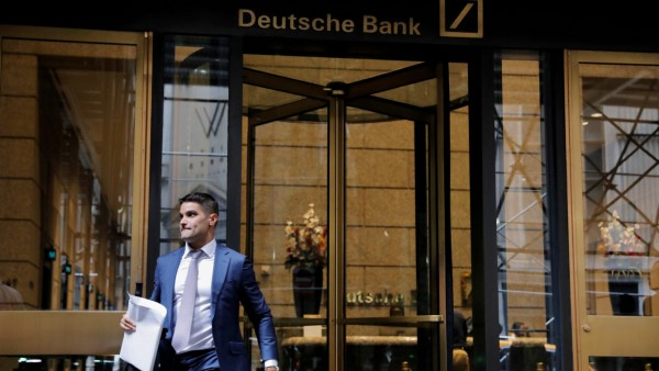 A man walks out of the U.S. headquarters of Deutsche Bank in New York City