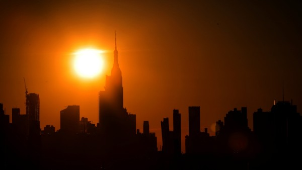 The sun sets on midtown Manhattan during a blackout in New York
