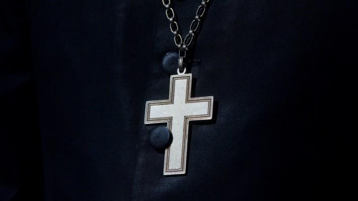 Kreuz an Halskette