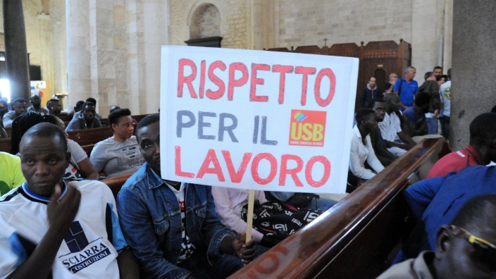 Foreign laborers residing in Foggia occupy the Basilica of San Nicola in protest for exploitation