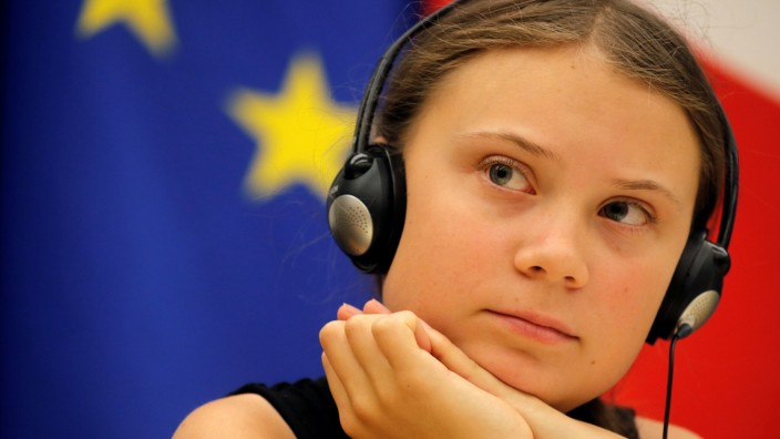 Swedish environmental activist Greta Thunberg attends a debate with French parliament members at the National Assembly in Paris