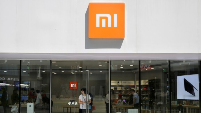 FILE PHOTO: A customer walks out of a Xiaomi store in Beijing