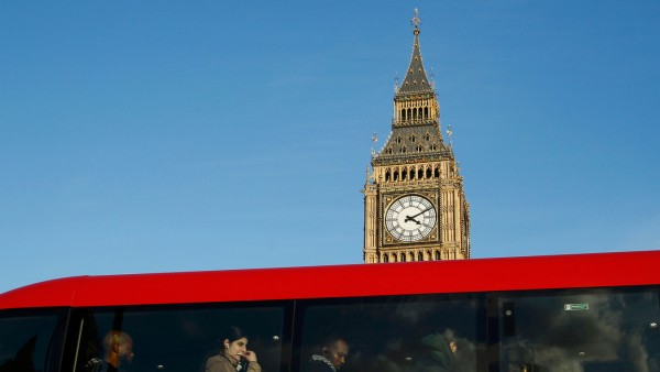 A bus full of passengers passes the Big Ben bell tower at the Houses of Parliament  in London, Britain