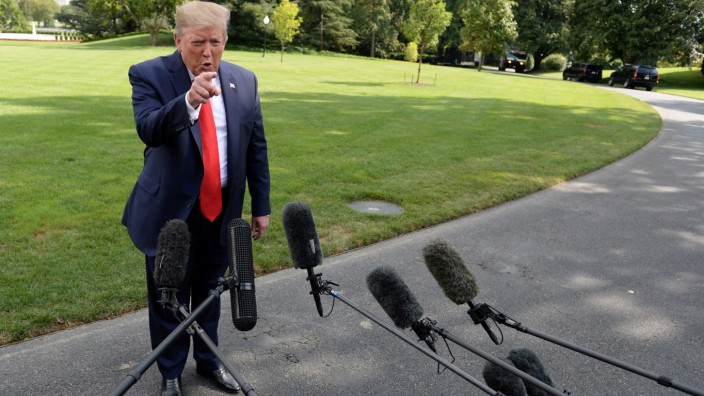U.S. President Donald Trump speaks to the media before departing the White House