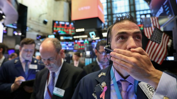 Traders work on floor of New York Stock Exchange (NYSE) after opening bell in New York